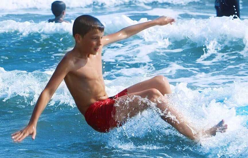 Surfing the Waves at Weligam Bay