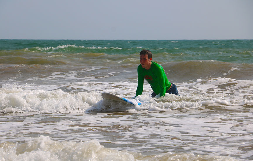 A surfer at Weligam Bay